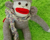 Sock Monkey Schnitzel needs a new home.  Large Rockford Red Heel sock monkey, made by hand in the USA.