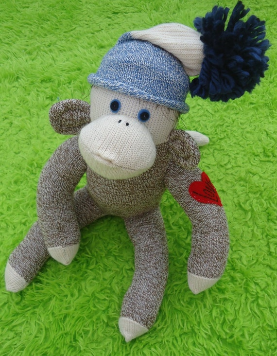 Valentino, the sock monkey with the heart tattoo.  American Rockford Red Heel Sock Monkey, made by hand in the USA.