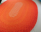 """Ready to ship 48""""x 66"""" bright orange rug braided from organic cotton and recycled t shirts"""