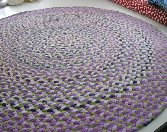 Wisteria rug made from braided new and recycled t shirts
