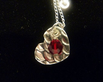 Fine silver scallop textured heart with red swarovski crystal dangle