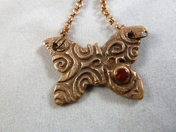 Bronze Butterfly with a Red CZ