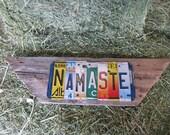 NAMASTE lotus flower om shanti ohm yoga upcycled recycled license plate art sign mounted on weathered wood tomboyART tomboy
