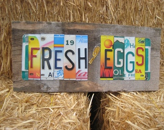 FRESH EGGS upcycled license plate art sign on barn wood tomboyART