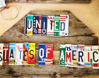 UNITED STATES of AMERICA upcycled recycle license plate art sign mounted on barn wood tomboyART OoaK Made in America Woody Guthrie