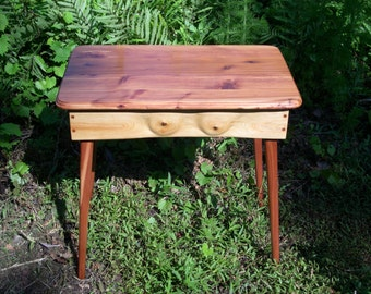 Bare chest table (end side hall) art