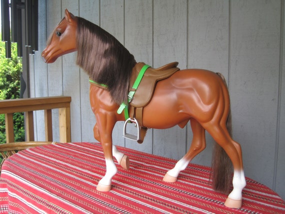 Large hard plastic toy horse and saddle