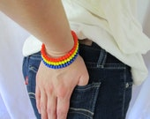 Beaded memory wire bracelet / coil bracelet in bright orange, yellow and cobalt blue