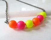 Neon Swarovski pearl necklace in hot pink, orange and yellow with a gunmetal chain