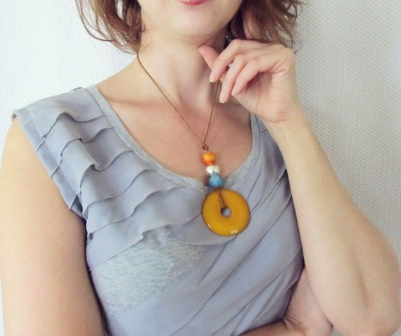 Jade pendant necklace in Orange candy Jade with silver, blue and orange Mykonos Greek ceramic beads on a leather cording