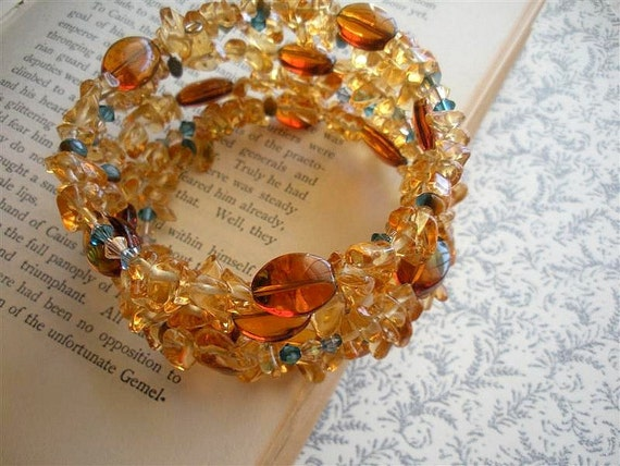 Memory wire beaded bracelet -Swarovski crystal and Piezo glass in gorgeous sunset colors topaz, amber, capri blue and champagne