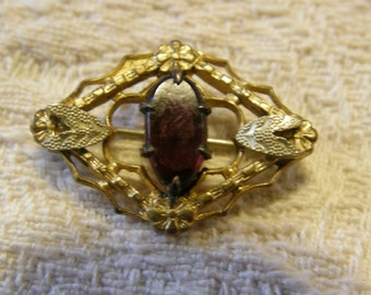 Antique Victorian gilt brooch with amethyst glass cabochon