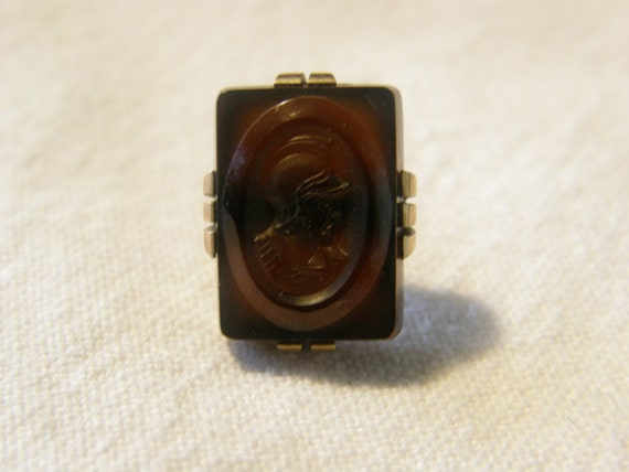 Vintage gold and amber intaglio soldier pin