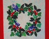 Quilted Wall Hanging - Green Holly and Ivy Wreath with Bright Red Berries and Bluebirds Against Sky Blue Background