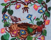 Quilted Wall Hanging - Morning Glory Wreath with Nest and Birds against Sky Blue Background