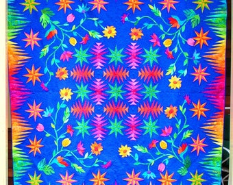 Quilt -- Pineapple Blocks and Appliqued Flowers in Orange, Yellow, Pink, Green and Red are set against a Blue-Purple Background