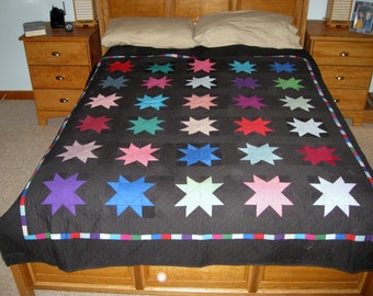 Quilt -- Amish Style Multicolored Stars Against Black