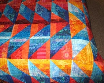Quilt -- Orange and Gold Arrows against Blue Diamonds