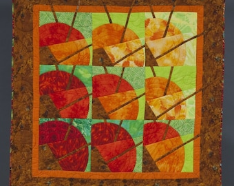 Quilt -- Contemporary Graphic Fans in Yellow, Orange and Red are Set against Green Backgrounds