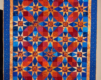 "Quilt -- Gold Stars and Red ""Circles"" are Set against Cobalt Blue Background"