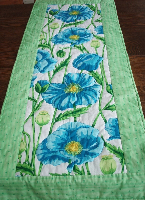 Quilted Table Runner -- Blue Poppies and Green Leaves Set Against White Background