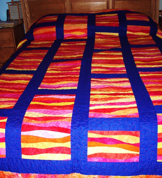 """Queen Size Quilt--RESERVED FOR ALI--with Blocks of Red, Yellow, Orange and Pink """"Ribbons"""" set Against Dark Cobalt Blue Sashing"""