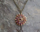 Purple Passion Sunburst Disc Necklace
