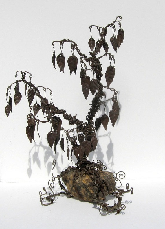 Delicate But Twisted Barbed Wire Tree With Rusty Leaves