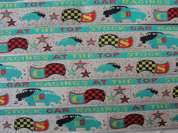Almost 2 yards of Racing Cars polyester trim. 1 inch width.