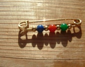 Safety Pin with Red Green Blue and Gold beads