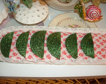 6 Green Woven Drink Coasters in wall hanging pockets