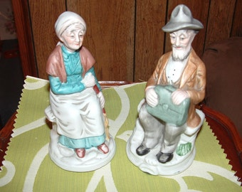 Older Resting Lady and Man Figurine