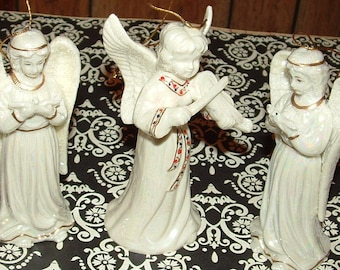 3 Vintage Porcelain Lusterware Christmas Angel Ornaments middle angel is a bell