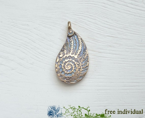 RESERVE LISTING for PALMSPROUT...Artisan Bronze Nautilus Pendant and two mini pendants