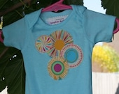 Girls Turquoise Onsie with Pastel Fireworks Applique (size 0-3 months)
