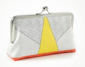 Clutch with yellow triangle