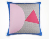 Pillow cover with pink triangle
