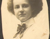 ON SALE Antique Photo of a Woman Wearing a Blouse with Large Bow Tie and She Has a Bouffant Hair Do