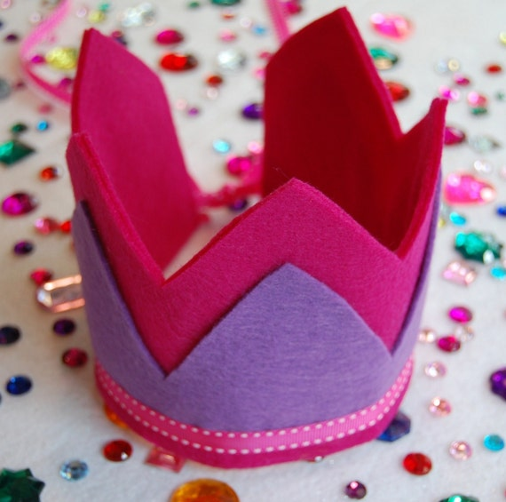 decorate your own felt crown kit-two color crown with overlay and adjustable ribbon tie comes with gemstones and felt pieces for decorating. your choice of crown colors