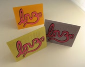 3 Love & Om Cursive Hand Printed Greeting Card in Orange, Blue and Green