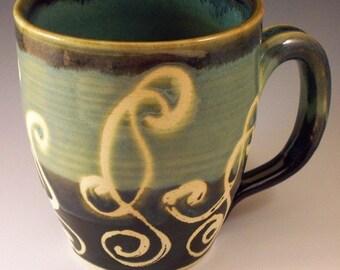 green swirly mug