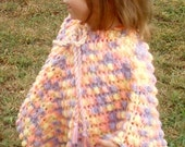child's pastel poncho