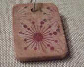 Starburst antiqued wooden pendant