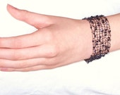 Black hand knitted beaded bracelet