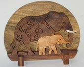 Wood Elephant Puzzle Sculpture - Mother's Caress in black walunt and mahogany