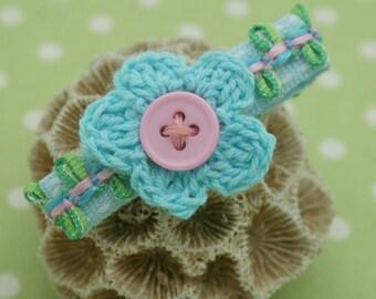 a pair of crochet flower clips