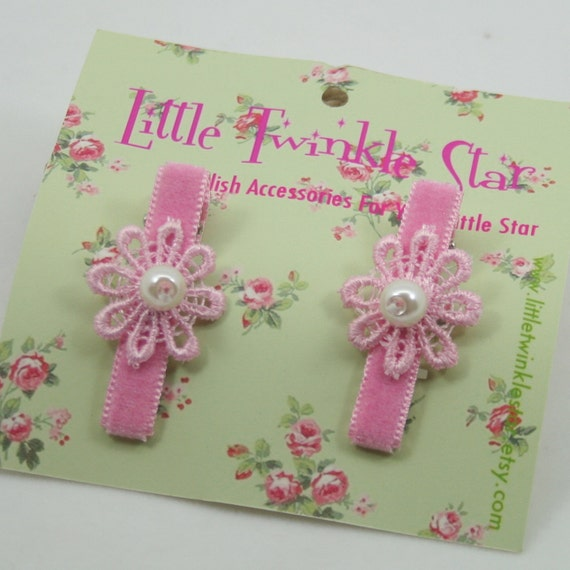 a set of pink clips