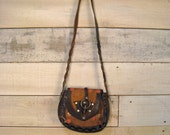 Vintage 1970s tooled leather purse with unique wooden peg and ring closure