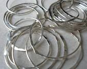 Dangling Hammered Silver Hoops Earrings