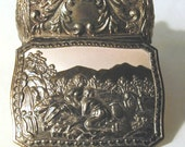 Ornate Silvertone Trinket Box with Two Classical Figures in a Natural Landscape